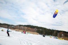 Men ski kiting on a frozen lake Stock Photo