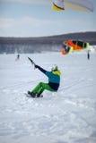 Men ski kiting on a frozen lake Stock Photos