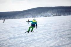 Men ski kiting on a frozen lake Stock Photography