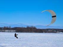 Men Ski Kiting On A Frozen Lake Royalty Free Stock Photo