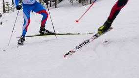 Men skiers marathon runners climb mountain classic style stock video