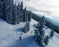 Men Skiers in Zillertal Arena ski resort in Tyrol Austria. Men Skiers in Zillertal Arena ski resort in Zillertal in Tyrol. Mayrhofen in Austria in winter in Alps stock image