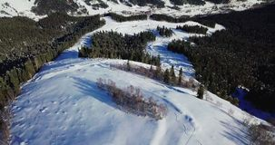Men are skiing in high mountains. Filmed by drone stock video footage