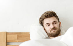 Men sleep on bed. In the morning with in badroom stock image