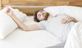 Men sleep on bed. In the morning with in badroom royalty free stock photography