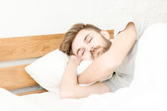 Men sleep on bed in the morning. With in badroom stock photos