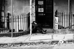 Men sleeping on the street after party, Bristol. ENGLAND, BRISTOL - 13 SEP 2015: Men sleeping on the street after party in Clifton, Bristol stock photo
