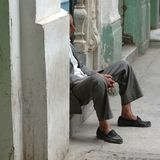 Men sleeping in Tripoli. Tripoli, Lybia - May 02, 2002: Men resting in Tripoli suq Stock Image