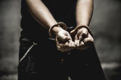 Prisoner. Men slept imprison show cuffs designed illuminations. Depressing picture tones Royalty Free Stock Photography
