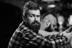 Men with smartphone relaxing at bar. Mobile dependence concept. Mobile phone always with me. Friday relaxation in bar. Hipster bearded men spend leisure at bar stock image