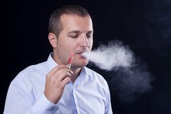 Men smoke  electronic cigarette Stock Photography