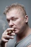 Men smoking cigar Royalty Free Stock Images