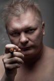 Men smoking cigar Stock Images