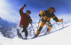 Men snowshoeing in Serre Chevalier. SERRE CHEVALIER, FRANCE - MARCH 15: Snowshoers Esben Pedersen and Lai Bokelund explore the backcountry of Serre Chevalier on Stock Images