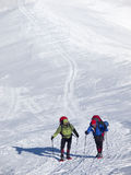 Men in snowshoes go in the mountains. Stock Image
