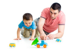 Men and son playing together Stock Photography