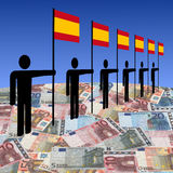 Men with Spanish flags on euros Stock Photo