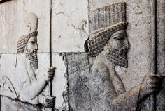 Men with Spears. A bas-relief carving of soldiers at the 2500 year old palace of Persepolis in Persia. Originally the home of Xerxes in approx 500 BC, the Stock Images