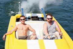 Men in a Speedboat Stock Photography