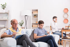 Men spending time at home. Generations of men spending time at home stock image