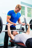 Men in sport gym training with barbell royalty free stock photo