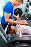 Men in sport gym training with barbell stock images