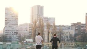 Men in sports wear in city.  stock video footage