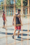 Men in sportswear standing on court after basketball game Royalty Free Stock Photos