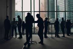 Men stand at the tables Royalty Free Stock Photos