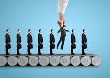 Men standing on conveyor Stock Photography