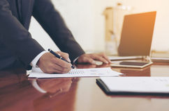 Men standing at desk and working writing document hand close up. royalty free stock image