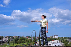 A men standing at a height and shows a finger Royalty Free Stock Images