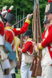Men Standing in Lines with Muskets Royalty Free Stock Image