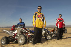 Men Standing By Quad Bikes In Desert Stock Photography