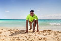 Men in start position. Black man in start position at the beach Royalty Free Stock Photography