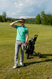 Men stay on green golf field. Beautiful men stay on green golf field Royalty Free Stock Photos