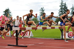 Men Steeplechase race. With Donn Cabral, an American cross country and track athlete. Harry Jerome International Track competition in Burnaby, BC, Canada Stock Photos