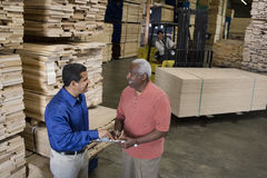 Men Stock Taking In Warehouse Stock Photography