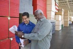 Men Stock Taking In Warehouse Royalty Free Stock Photos