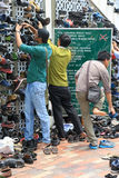 Men storing their shoes before entering a mosque Royalty Free Stock Photo
