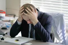 Men stressed out at work stock photos