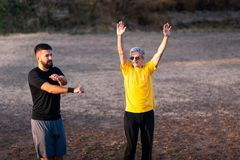 Men stretching before a workout outdoors. Healthy lifestyle royalty free stock image