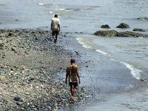 Men strolling the beach. Life in India: two men walking down the beach at Marine Drive, Mumbai Royalty Free Stock Photos