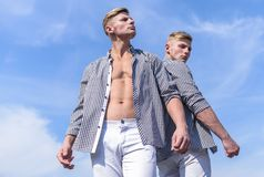 Men strong athlete wear same shirts. Menswear and fashion concept. Brothers twins looks attractive. Fashionable similar. Outfits. Men twins brothers muscular stock image