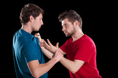 Men during struggle. Angry men during struggle on isolated background stock photography