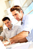 Men studying in classroom Royalty Free Stock Image
