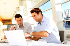 Men studying in classroom Stock Photo