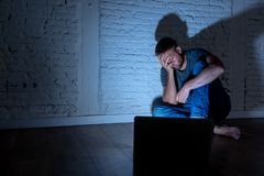 Free Men Suffering Internet Cyber Bullying Sitting Alone With Computer Feeling Hopeless Royalty Free Stock Image - 136022196