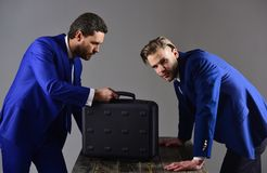Men in suit or business partners with busy faces meet Stock Photos