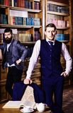 Men in suit, detectives spend leisure in library. Private investigator and detective concept. Retro detectives work on investigation in antique room or library royalty free stock photography